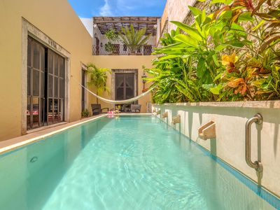 5 ft deep lap pool with waterfall spouts