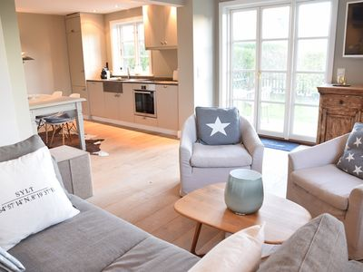 Photo for Stylish 100m² apartment with WiFi, parking and garden for 4 people on the ground floor, Am Seedeich 11, ground floor, Beach House 1