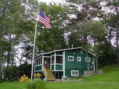 Photo for Cozy waterfront cottage at Weirs Beach perfect for swimming, fishing and kayaking