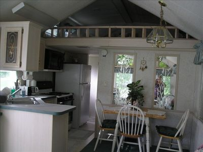 Kitchen and dining area showing loft in overhead