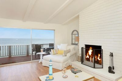 Luxurious living room with ocean views & wood burning fireplace