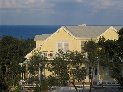 Exterior of Yellow House with Ocean in Background