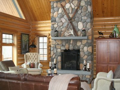 Photo for Slope side log chalet with breathtaking views of the mountains. Fits 2 families.