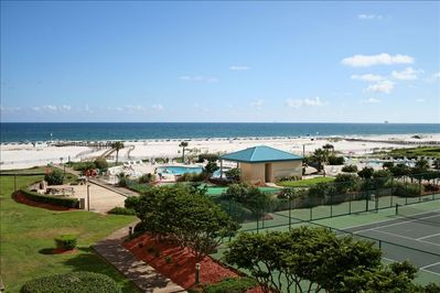 Condo overlooks courtyard with 2 pools, hot tub, picnic area, putting green!