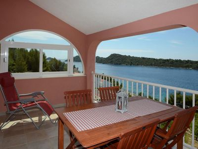 Photo for Two bedroom apartment with terrace and sea view Karbuni, Korčula (A-13217-d)