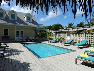 Photo for Fashionable Compound w/ 3 Heated Pools, Golf Carts, Walk To Town and Beach