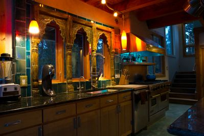 beautiful architectural piece from India and custom torquoise tile backsplash.
