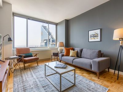 Photo for Open Midtown West 1BR w/ roomy sundeck, gym, near Times Sq by Blueground