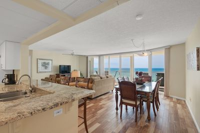 Gorgeous gulf view from kitchen, dining and living room areas. New tile flooring