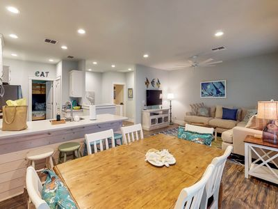 Photo for Comfortable, dog-friendly townhome - walk to the beach, shared pool!