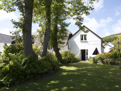 Photo for Manor Cottage, Croyde Village/sleeps 6/tucked away location/800m from beach