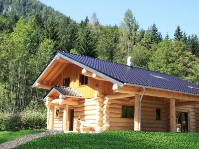 Photo for Unique log cabin in the Alps with terrace, swimming pool and sauna