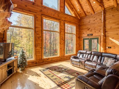 Photo for Custom-built cabin with double sided fireplace and wall of windows! Easy access to activities!