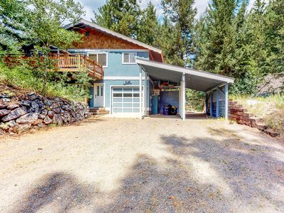 Photo for Cozy tree-lined home w/ deck & forest views - steps to downtown, 2 dogs OK!