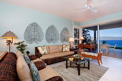 Living room with desk looking out to the ocean. Palacek and McGuire furniture
