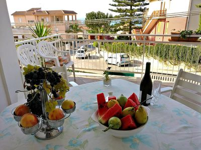 Photo for AL038 Apartment by the sea 7posti air conditioned veranda bbq wi-fi