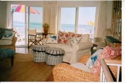 Living room offers plenty of lounge seating with friends & family