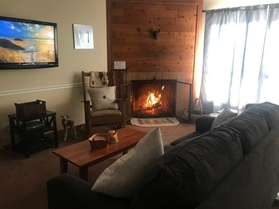 Photo for Ski right home to Trail Creek! Beautifully updated 1br condo, fireplace, hot tub