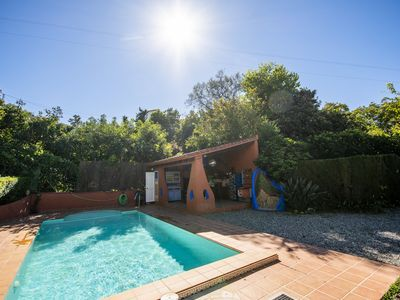 Photo for Cubo's Casa Bonilla. Garden with pool and BBQ, wifi, AC, amazing views