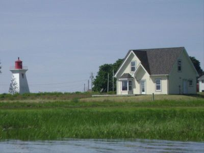 East side of cottage with the tide in.  Taken from our boat.