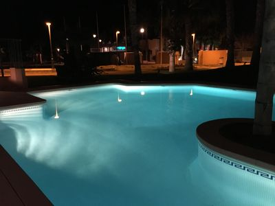 Pool area at night looking towards the beach & Spinosa bar & restaurant