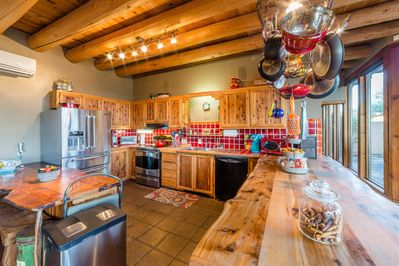 Bright, cheery, well-stocked kitchen. Cedar Slab countertops. Induction Range.