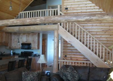 Log siding and railings make this Great Room warm and inviting.