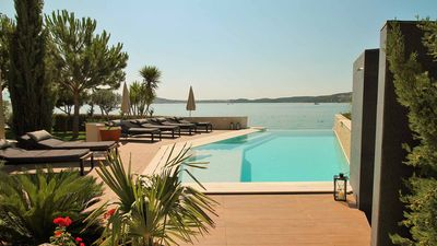 Photo for Luxurious beachside apartment Sea Note with shared pool EOS-CROATIA