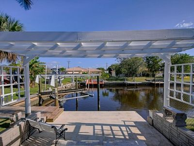 Photo for SE Cape Coral | Direct Access | Infinity edge pool & hot tub, Yacht Club location, minutes from Cape