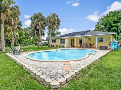 Photo for Newly Listed! Secluded North Fort Myers Family Home! .75 Acres w/Canal, Fire Pit, Pool & Free WiFi!