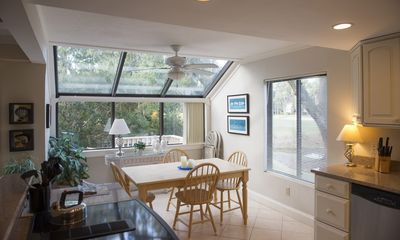 Sunny dining area for 6 with stunning panoramic view of lagoon and golf course.