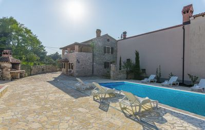 Photo for Little stone holiday house Luan with shared Pool on Quiet location near Poreč