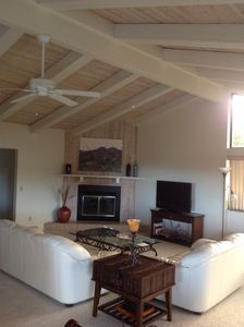 Living Room area with fireplace and vaulted ceilings