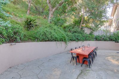 Enjoy dining al fresco and entertain family and friends in the large backyard!