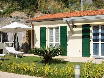 Photo for Apartment in a holiday park with a private beach directly on the Ligurian Sea