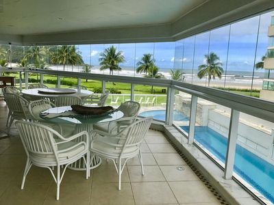 Photo for Apartment 5 Suites Foot in the sand overlooking the beach of the Riviera de São Lourenço