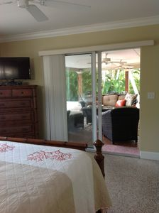 Sliding glass doors from master out to pool and canal.