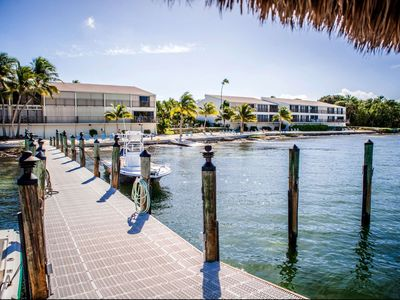 Photo for February 2020 available! Tropical getaway at Executive Bay, heated pool, fish off the dock, tennis