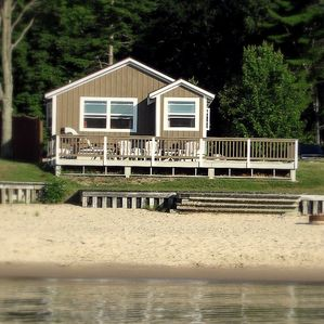Front of cabin from the water. Renters enjoy a private beach.