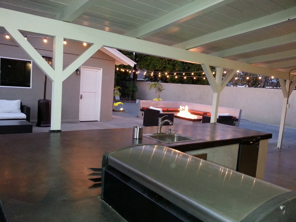 Outdoor kitchen overlooking the firepit and game room