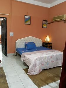 Large and privacy bedroom with air-conditioned and sofas .