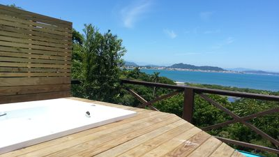 Photo for Terrace with Jacuzzi, overlooking the sea, a kiosk with barbecue, Air Cond