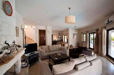 Large living room with a fire place just in case you want to come in late autumn