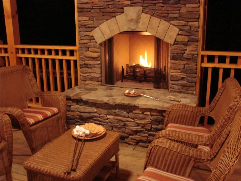 cabin with fireplace. The outdoor fireplace is a wonderful gathering place Waterfront  Luxury 4 3 Cabin with Hot Tub VRBO