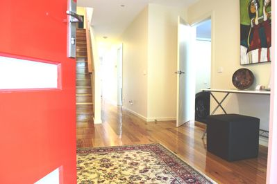 Step through the Red Door to the show home behind
