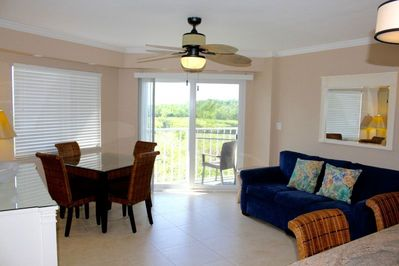 Living room with a queen-size sleeper sofa in the living room that accommodates 2 guests.