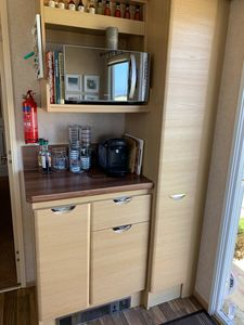 Photo for Beautifully decorated caravan right next to the sea with picturesque views