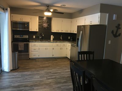 Kitchen and dining are in the lower level.