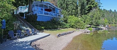 Photo for Relax at this one of a kind lakeside cabin featuring a private beach and dock