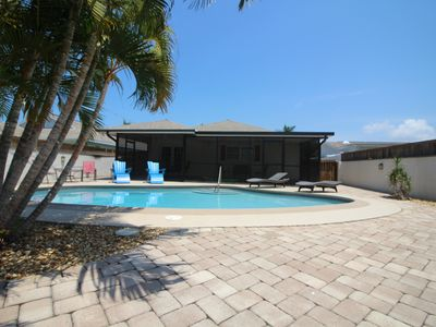 Photo for Remodeled 2017,  Private south facing- heated pool, walk to beach